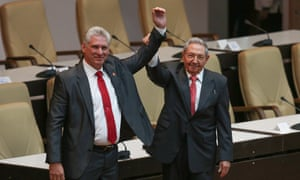 Raúl Castro, right, raises the hand of his successor as president of Cuba, Miguel Díaz-Canel at the national assembly in Cuba on Thursday.