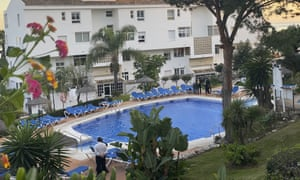 Divers examine a swimming pool at the Club La Costa World holiday resort.