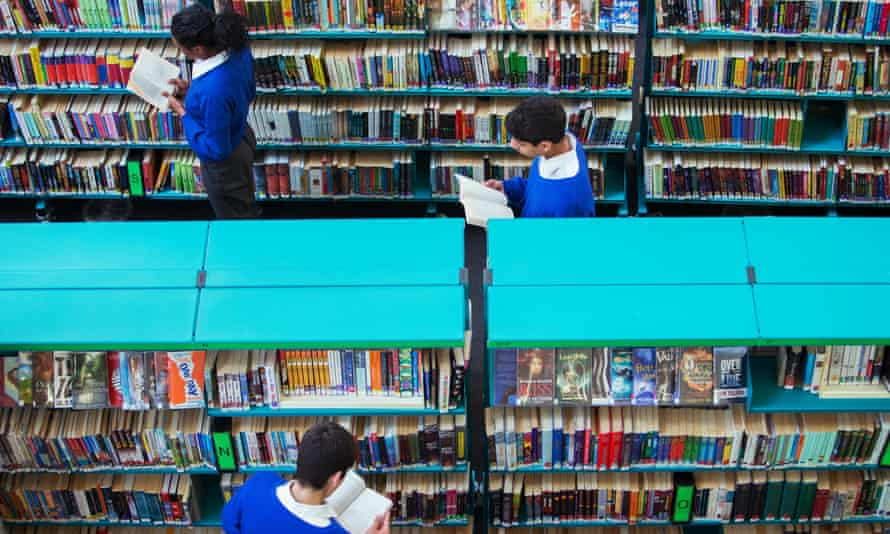 Pupils browse in a school library.