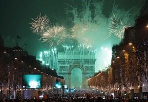 The Arc de Triomphe illuminated at midnight in Paris