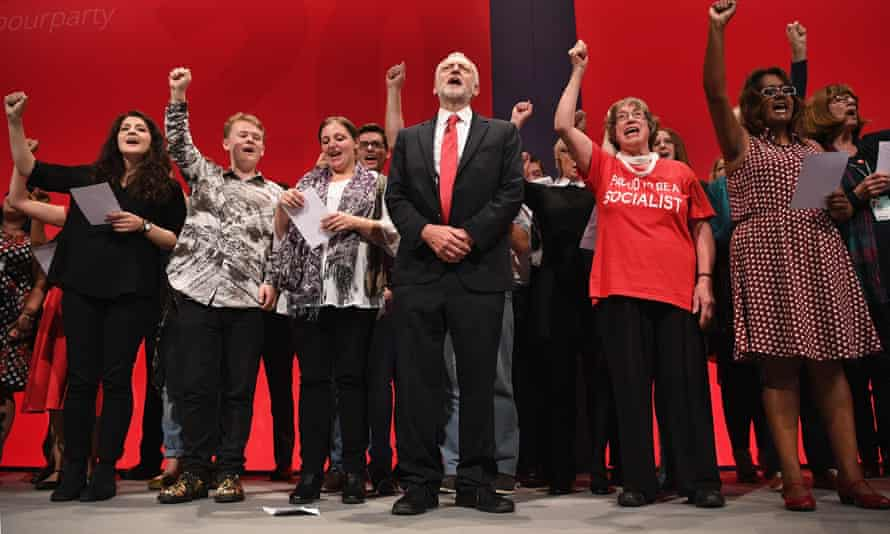 Jeremy Corbyn sings The Red Flag on stage with party members at the party conference.