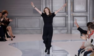 Clare Waight Keller acknowledges the audience after the presentation of Chloe creations in Paris