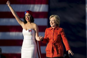 Democratic presidential candidate Hillary Clinton arrives with singer Katy Perry during a campaign rally.