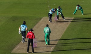 England's Eoin Morgan smashes a six to win the game.
