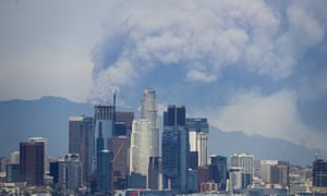 Columns of smoke from the mountain fires visible from downtown LA on 20 June.