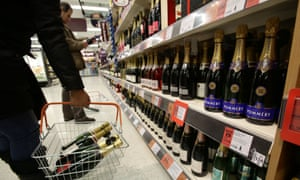 Shoppers choosing Champagne ahead of New Year's Eve celebrations in a Sainsbury's store in Tottenham, north London.