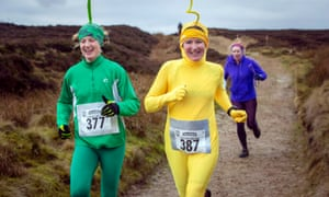 Competitors dressed as Teletubbies in fancy dress run in the annual Auld Lang Syne fell race.