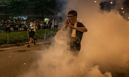 A protester reacts to police teargas outside the Legislative Council complex on Tuesday.