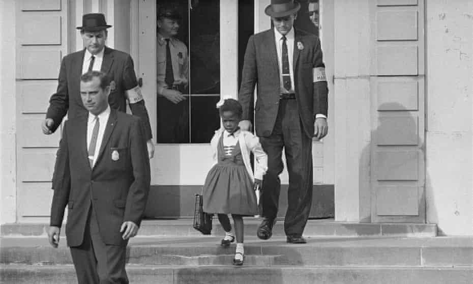 Ruby Bridges with an escort of US deputy marshals leaves school in November 1960.