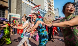 Chinese women dressed in traditional qipao take part in a flash mob in São Paulo, Brazil, 19 August.