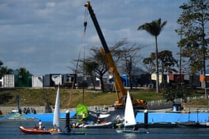 Construction workers are seen repairing the broken boat ramp at the Olympic sailing venue at Marina da Gloria.
