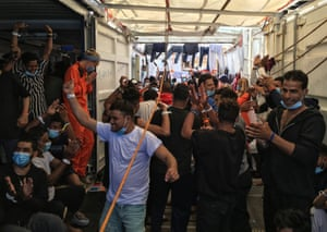 Migrants react aboard the Ocean Viking rescue ship, operated by French NGO SOS Mediterranee, after Italy announced they would be authorised to land, on 5 July, 2020, in the Mediterranean Sea.