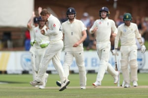 England's Dom Bess celebrates taking the wicket of South Africa's Anrich Nortje.