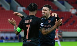 Phil Foden celebrates with Raheem Sterling after scoring Manchester City's opening goal.