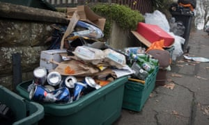 Full recycling bins on pavement in Bristol