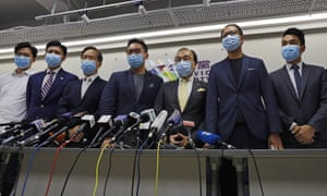 Opposition candidates hold a press conference after being barred from standing for election, on 30 July.