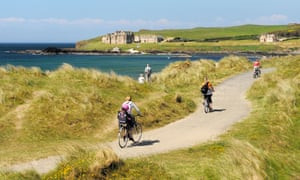Explore the Irish coast by bike along routes such as the Runkerry Trail, which runs to the Giant's Causeway.