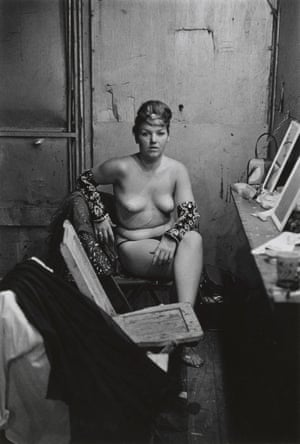 Stripper with bare breasts sitting in her dressing room, Atlantic City, NJ, 1961