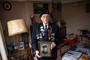 Merchant navy veteran Bill Bennett, 94, wears his medals at his home in Kidderminster