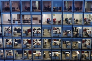 Workers in an office at night