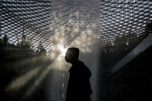 A man walks past the Rain Vortex at the Jewel Changi Airport mall in Singapore, which is experiencing a third wave of imported Covid-19, with over 100 such cases in the last month.