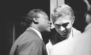 Miles Davis in conversation with actor Steve McQueen, backstage at the 1963 Monterey jazz festival.
