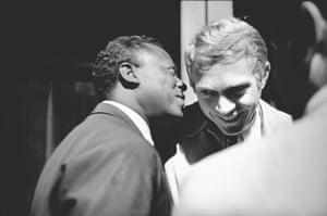 Miles Davis and Steve McQueen backstage at the Monterey jazz festival, 1963 by Jim Marshall