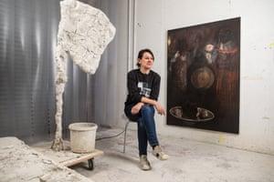 Rebecca Warren photographed in her studio with Fergal Stapleton's painting Hours (2010- 16).