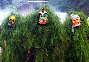 Guangxi, China. People dress up as Manghao, a folkloric god, during spring festival celebrations