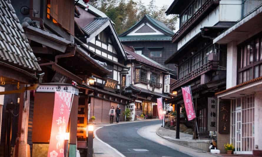 Edo-era shophouses in a small street in central Narita .