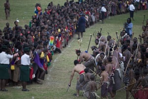 King Mswati III dances in front of young virgins at a traditional reed dance ceremony at the stadium at the Royal Palace, in Ludzidzini, 2009