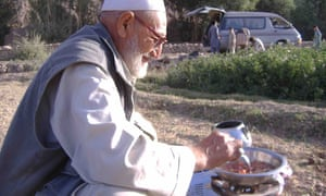 lunch is heated by the roadside in Afghanistan.