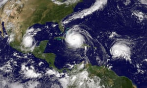 Satellite image showing Hurricane Irma (C) in the Caribbean Sea, Tropical Storm Jose (R) in the Atlantic Ocean and Tropical Storm Katia in the Gulf of Mexico in September 2017 - causing widespread destruction across their paths