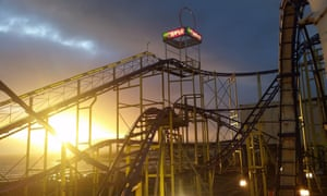 Rollercoaster ride, at sunset, at Barry's Amusements, Portrush, Northern Ireland.
