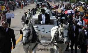 A horse-drawn carriage carries Floyd's casket to the Houston Memorial Gardens cemetery in Pearland.