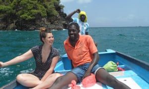 Clara and Nkosi on a boat in 2014