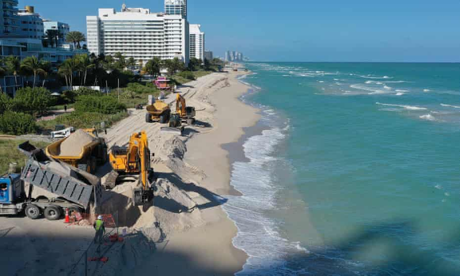 The US Army Corps of Engineers distributes sand along the beach in Miami Beach, Florida. The project is part of a $16m scheme to widen the beaches in an effort to fight erosion and protect properties from storm surges.