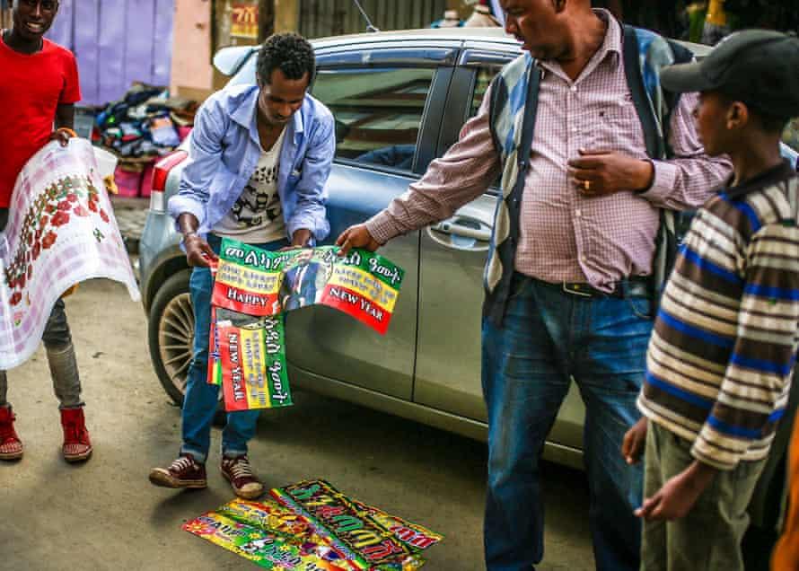 A vendor sells posters of Abiy Ahmed
