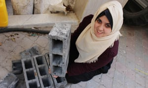 Majd Mashharawi produces cement blocks and stones in Gaza using materials salvaged from houses destroyed by Israeli shelling during the 2014 conflict.