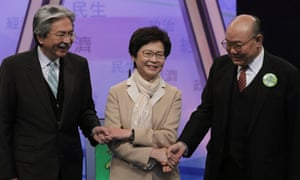 From left, John Tsang, Carrie Lam, and Woo Kwok-hing greet each other before a televised debate.