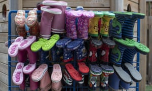 Children's wellies are hung on a rack at a primary school in London