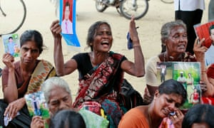 Tamil women hold portraits of their missing relatives during a protest in Jaffna, Sri Lanka, in November 2013 during a visit by British PM David Cameron.