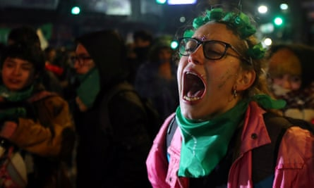 A woman reacts after senators rejected a bill to legalise abortion