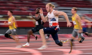 Jonnie Peacock on his way to a bronze medal in the 100m T64 final.