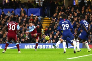 Aaron Cresswell curls the ball past Zouma to put West Ham ahead at Stamford Bridge.