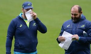 Mario Ledesma, right, stands next to Australia's head coach Michael Cheika