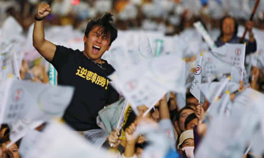 A Tsai supporter celebrates the election results.