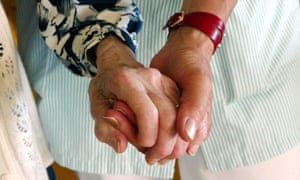 A care worker helps an elderly client