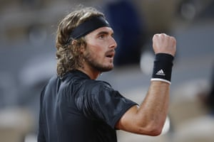 Greece's Stefanos Tsitsipas clenches his fist after scoring a point during the third set.