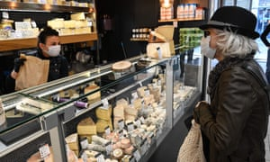 A customer buying cheese at a shop in Montpellier
